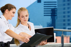 Two happy businesswomen with documents Stock Images