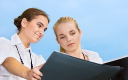 Two happy businesswomen with documents Stock Image