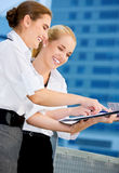 Two happy businesswomen with paper chart Stock Images