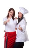 Two happy chefs. A studio view of two female cooks giving a happy thumbs up.  White background Stock Photos