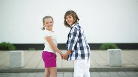 Two Happy Child. They Hold Hands and Unfold Smiling and Laughing. Fun, HD, Teeth, Cheerful stock video
