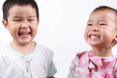 Two happy children. Two children full of smiles with white background stock photos