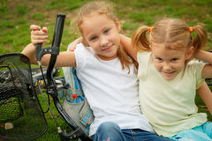 Two happy children on a bicycle Stock Images