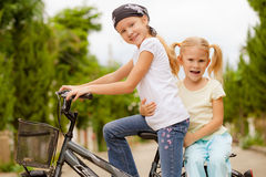 Two happy children on a bicycle Stock Photography