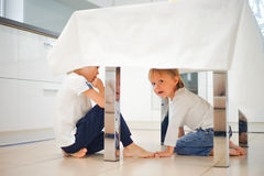 Two happy children in kitchen Stock Photography