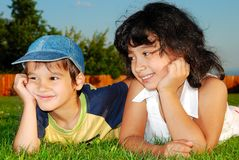 Two happy children on meadow Stock Photo