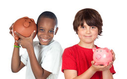 Two happy children with moneybox savings. Isolated over white Stock Images