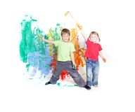 Two happy children painting white wall Stock Image