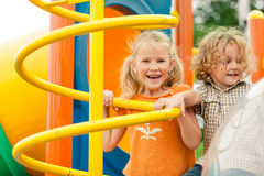 Two happy children on the playground Stock Photos
