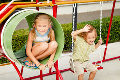 Two happy children on the playground Stock Image