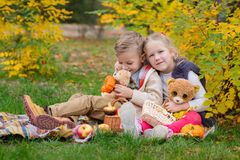 Two happy children playing in the autumn park Stock Photos