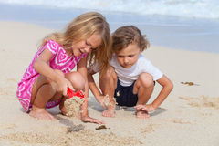 Two happy children  playing on the beach Royalty Free Stock Images