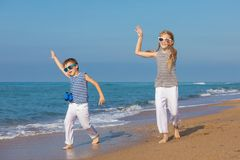 Two happy children playing on the beach at the day time Royalty Free Stock Image