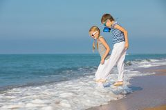 Two happy children playing on the beach at the day time Royalty Free Stock Photos