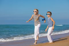 Two happy children playing on the beach at the day time Stock Photo