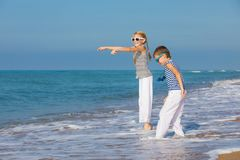 Two happy children playing on the beach at the day time Stock Photography