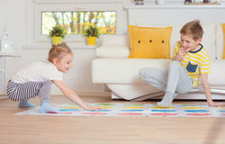 Two happy children playing exciting game at home Stock Photo