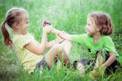 Two happy children  playing near the tree at the day time. Stock Images