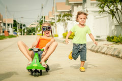Two happy children playing on the road Royalty Free Stock Photo