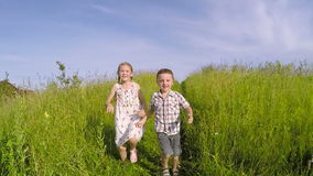 Two happy children playing on the road at the day time. Concept of  Brother And Sister Together Forever stock video