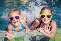 Two happy children  playing on the swimming pool at the day time Royalty Free Stock Photography
