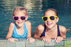 Two happy children  playing on the swimming pool at the day time Royalty Free Stock Photo