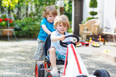 Two happy children playing with toy car Royalty Free Stock Photos