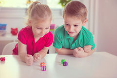 Two Happy Children Playing With Dices Stock Photo