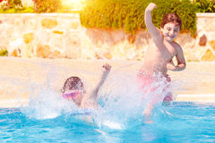 Two happy children in the pool Stock Photography