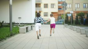 Two Happy Children Run Together Holding Hands. Their Blond Hair Wave Out On The Wind. HD, Fun, Together, Outdoor stock video footage