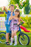 Two happy children sitting on bicycle Stock Image