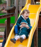 Two happy children on slide Royalty Free Stock Photo