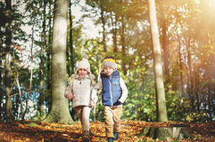 Two happy children walking through the forest Royalty Free Stock Images
