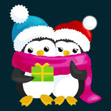 Two happy cute Christmas penguin in hat and scarf  Stock Photography