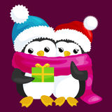 Two happy cute Christmas penguin in hat and scarf are a stack of  gifts  Stock Image