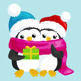 Two happy cute Christmas penguin in hat and scarf are a stack of  gifts on the eve  Stock Photo