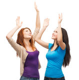Two happy dancing girls Royalty Free Stock Images