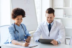 Two happy doctors meeting at hospital office Royalty Free Stock Image