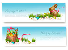 Two Happy Easter banners with easter eggs in a basket. Royalty Free Stock Photography
