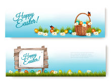 Two Happy Easter banners with Easter eggs in a basket. Stock Photography
