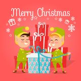 Two Happy Elves with Present on White Background Stock Photography