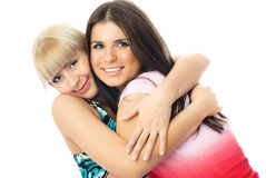 Two happy embracing friends Stock Image