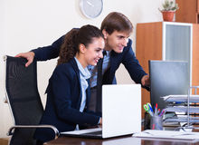 Two happy employees in office Stock Photography