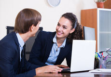 Two happy employees in office royalty free stock photos