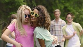 Two happy energetic girls dancing to music together, having fun at outdoor party. Stock footage stock video footage