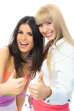 Two happy excited girls with their thumbs up Royalty Free Stock Image