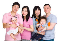 Two happy family with baby Royalty Free Stock Image