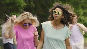 Two happy female dancers enjoying party outdoors, friends hanging out in park. Stock footage stock video footage