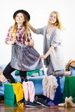 Two happy female friends after shopping. Two happy joyful women having fun after shopping, picking outfit in closet. Female friends fooling around stock images