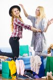 Two happy female friends after shopping. Two happy joyful women having fun after shopping, picking outfit in closet. Female friends fooling around royalty free stock photos